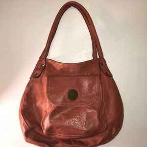 Pre owned burnt orange AXcess purse.